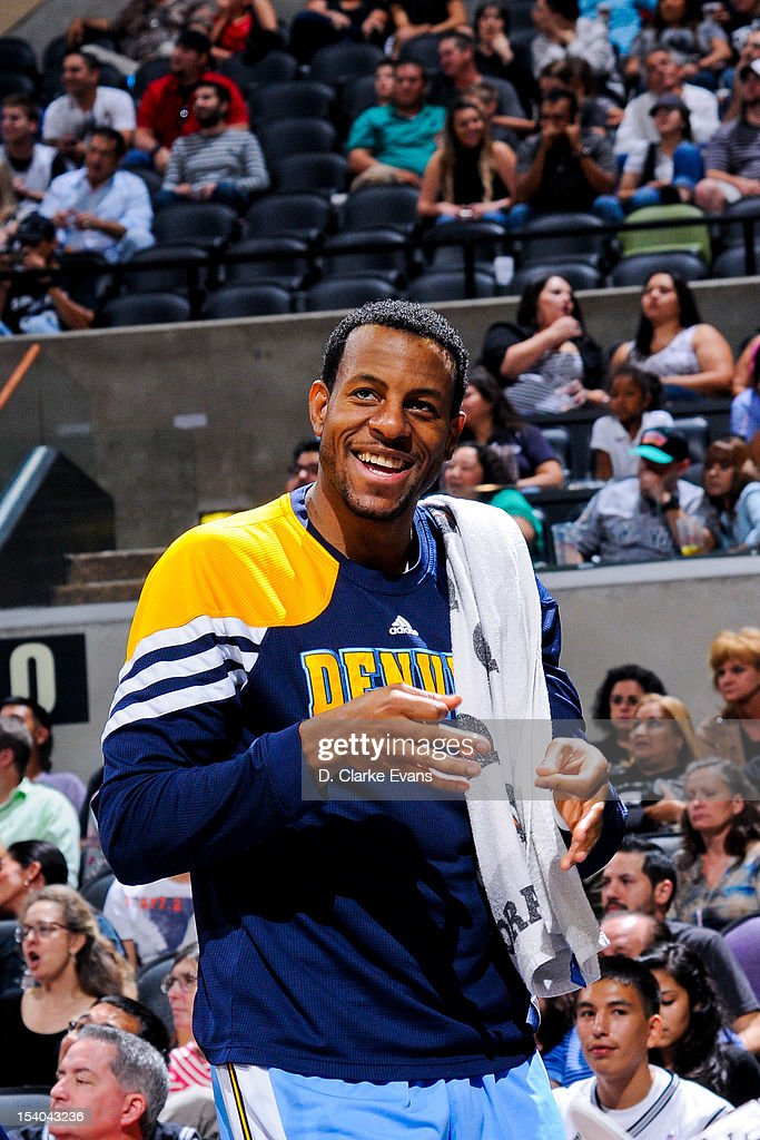 <a gi-track='captionPersonalityLinkClicked' href=/galleries/search?phrase=Andre+Iguodala&family=editorial&specificpeople=201980 ng-click='$event.stopPropagation()'>Andre Iguodala</a> #9 of the Denver Nuggets smiles from the sideline while playing the San Antonio Spurs during a pre-season game on October 12, 2012 at the AT&T Center in San Antonio, Texas.