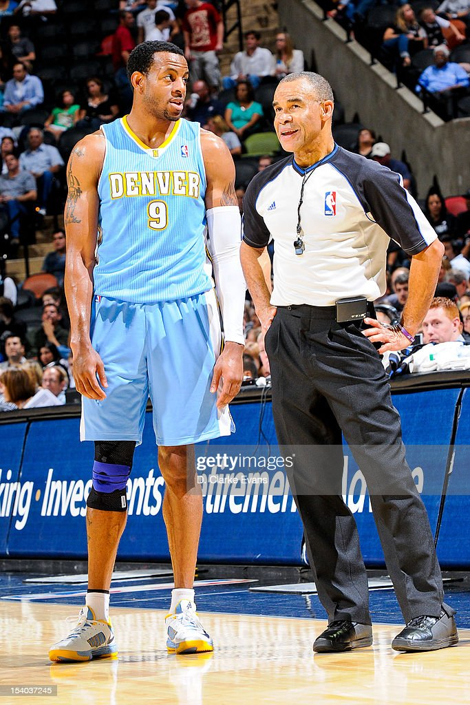 Andre Iguodala #9 of the Denver Nuggets speaks to referee Dan Crawford #43 during a pre-season game against the San Antonio Spurs on October 12, 2012 at the AT&T Center in San Antonio, Texas.