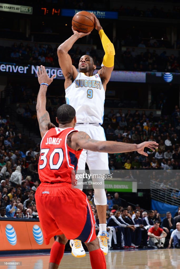 <a gi-track='captionPersonalityLinkClicked' href=/galleries/search?phrase=Andre+Iguodala&family=editorial&specificpeople=201980 ng-click='$event.stopPropagation()'>Andre Iguodala</a> #9 of the Denver Nuggets takes a shot against the Atlanta Hawks on March 4, 2013 at the Pepsi Center in Denver, Colorado.