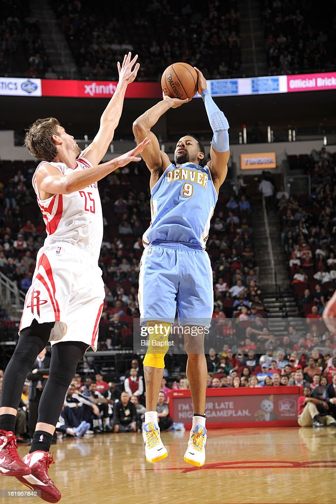 <a gi-track='captionPersonalityLinkClicked' href=/galleries/search?phrase=Andre+Iguodala&family=editorial&specificpeople=201980 ng-click='$event.stopPropagation()'>Andre Iguodala</a> #9 of the Denver Nuggets takes a shot against the Houston Rockets on January 23, 2013 at the Toyota Center in Houston, Texas.