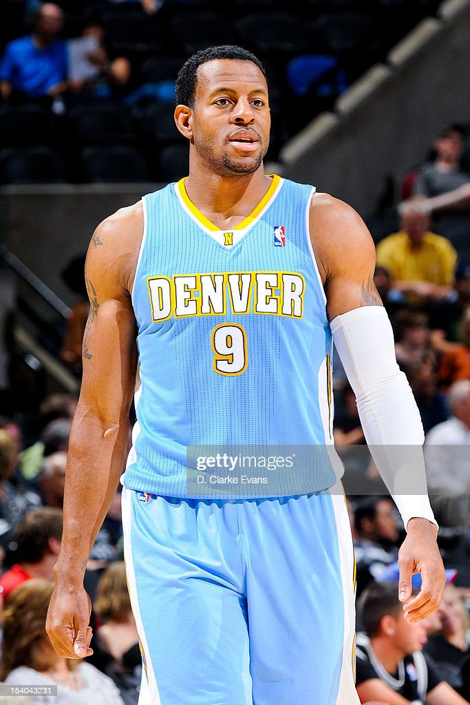<a gi-track='captionPersonalityLinkClicked' href=/galleries/search?phrase=Andre+Iguodala&family=editorial&specificpeople=201980 ng-click='$event.stopPropagation()'>Andre Iguodala</a> #9 of the Denver Nuggets waits to resume action against the San Antonio Spurs during a pre-season game on October 12, 2012 at the AT&T Center in San Antonio, Texas.
