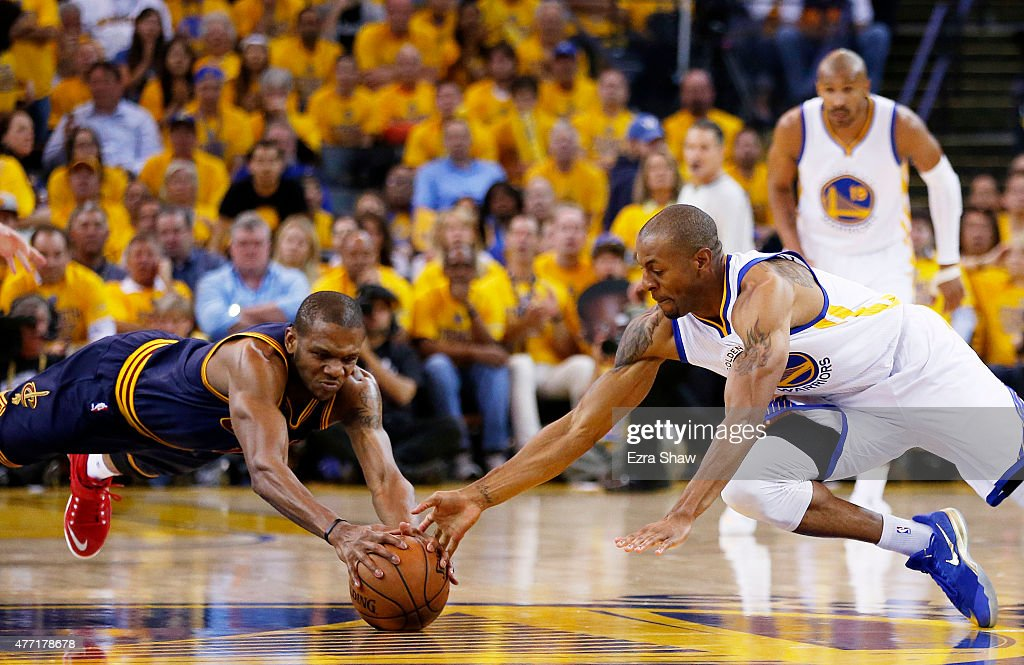 Andre Iguodala of the Golden State Warriors and James Jones of the Cleveland Cavaliers vie for a loose ball in the second quarter during Game Five of...