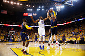 Andre Iguodala of the Golden State Warriors and Timofey Mozgov of the Cleveland Cavaliers vie for a rebound in the first quarter during Game Five of...