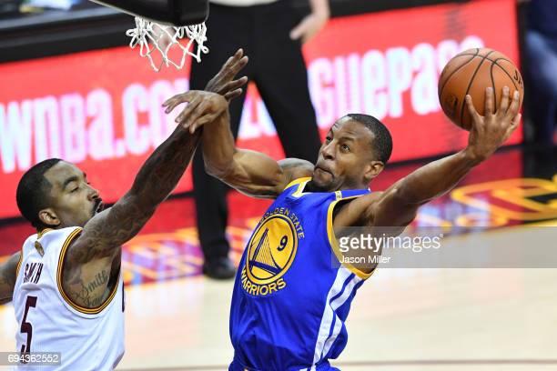Andre Iguodala of the Golden State Warriors attempts a shot against JR Smith of the Cleveland Cavaliers in Game 4 of the 2017 NBA Finals at Quicken...