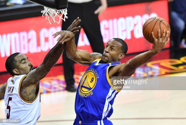 Andre Iguodala of the Golden State Warriors attempts a shot defended by JR Smith of the Cleveland Cavaliers in Game 4 of the 2017 NBA Finals at...