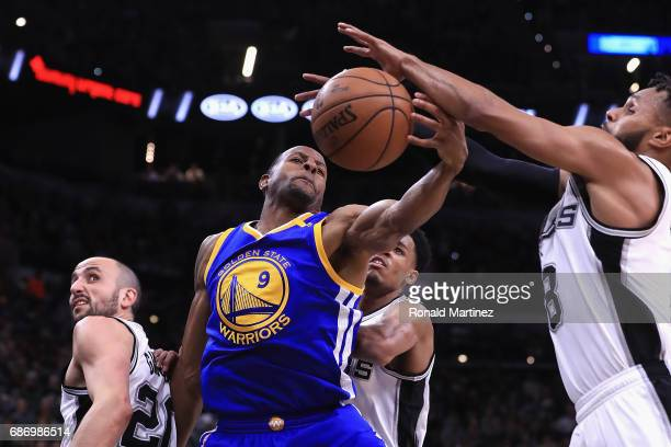 Andre Iguodala of the Golden State Warriors battles for the ball with Patty Mills of the San Antonio Spurs in the first half during Game Four of the...