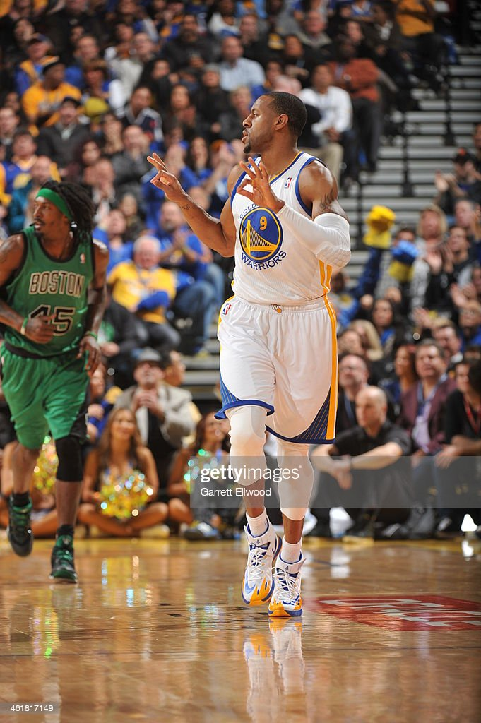 <a gi-track='captionPersonalityLinkClicked' href=/galleries/search?phrase=Andre+Iguodala&family=editorial&specificpeople=201980 ng-click='$event.stopPropagation()'>Andre Iguodala</a> #9 of the Golden State Warriors celebrates after making a three pointer against the Boston Celtics on January 10, 2014 at Oracle Arena in Oakland, California.