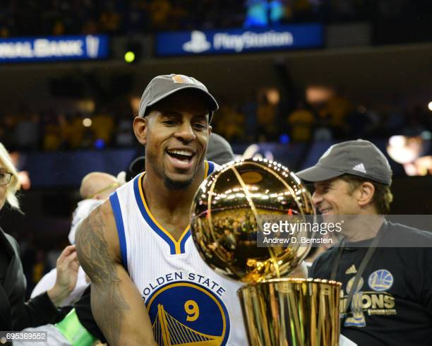 Andre Iguodala of the Golden State Warriors celebrates after winning the 2017 NBA Finals on June 12 2017 at ORACLE Arena in Oakland California NOTE...