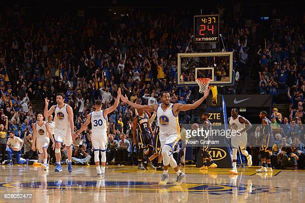 Andre Iguodala of the Golden State Warriors celebrates and runs up court during the game against the Indiana Pacers on December 5 2016 at ORACLE...