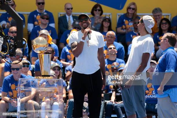 Andre Iguodala of the Golden State Warriors celebrates winning the 2017 NBA Championship during a parade on June 15 2017 in Oakland CA NOTE TO USER...