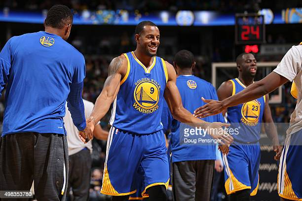 Andre Iguodala of the Golden State Warriors celebrates with teammate as he heads to the bench for a time out against the Denver Nuggets at Pepsi...