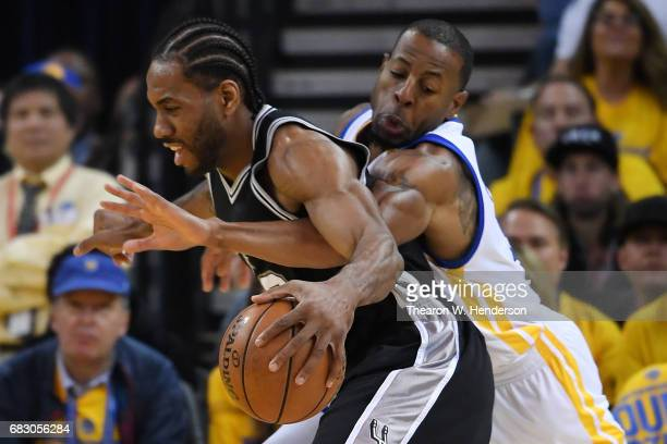 Andre Iguodala of the Golden State Warriors defends against Kawhi Leonard of the San Antonio Spurs during Game One of the NBA Western Conference...
