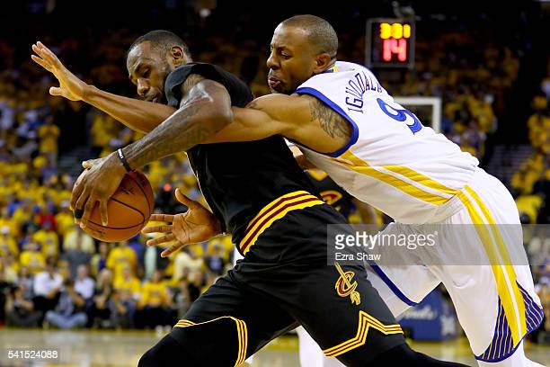 Andre Iguodala of the Golden State Warriors defends LeBron James of the Cleveland Cavaliers in Game 7 of the 2016 NBA Finals at ORACLE Arena on June...