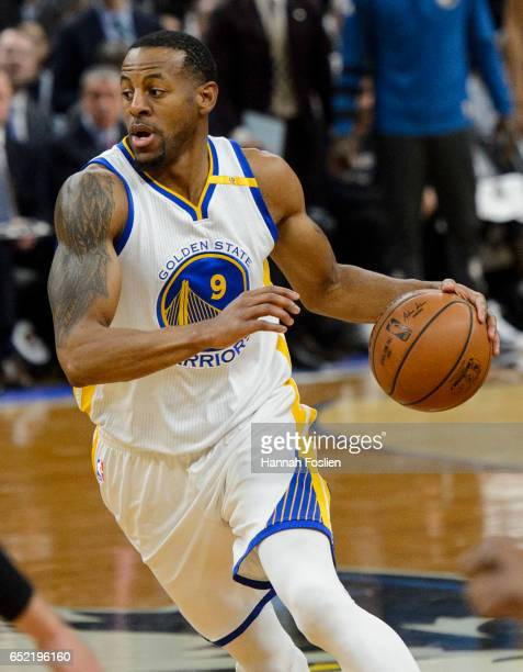 Andre Iguodala of the Golden State Warriors dribbles the ball against the Minnesota Timberwolves during the second quarter of the game on March 10...