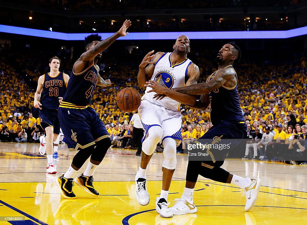 Andre Iguodala of the Golden State Warriors drives against JR Smith of the Cleveland Cavaliers in the first half during Game One of the 2015 NBA...