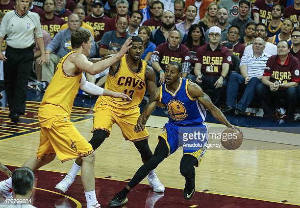 Andre Iguodala of the Golden State Warriors drives against Timofey Mozgov and Tristan Thompson of the Cleveland Cavaliers during Game Four of the...