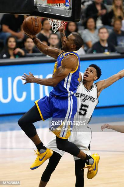 Andre Iguodala of the Golden State Warriors drives to the basket against Dejounte Murray of the San Antonio Spurs in the second half during Game Four...