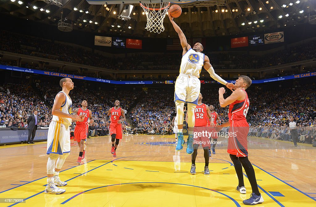 <a gi-track='captionPersonalityLinkClicked' href=/galleries/search?phrase=Andre+Iguodala&family=editorial&specificpeople=201980 ng-click='$event.stopPropagation()'>Andre Iguodala</a> #9 of the Golden State Warriors drives to the basket against the Atlanta Hawks on March 7, 2014 at Oracle Arena in Oakland, California.