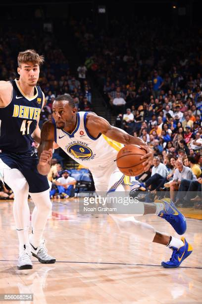 Andre Iguodala of the Golden State Warriors drives to the basket during the game against the Denver Nuggets during a preseason game on September 30...