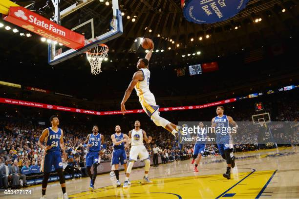 Andre Iguodala of the Golden State Warriors dunks against the Philadelphia 76ers during the game on March 14 2017 at ORACLE Arena in Oakland...