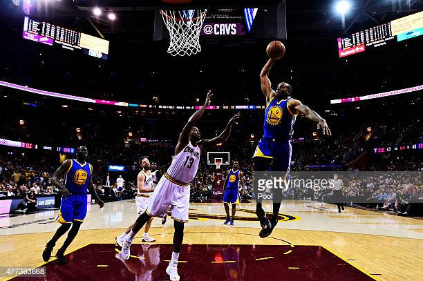 Andre Iguodala of the Golden State Warriors dunks against the Cleveland Cavaliers in the second half during Game Six of the 2015 NBA Finals at...