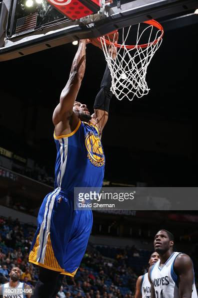 Andre Iguodala of the Golden State Warriors dunks against the Minnesota Timberwolves on December 8 2014 at Target Center in Minneapolis Minnesota...