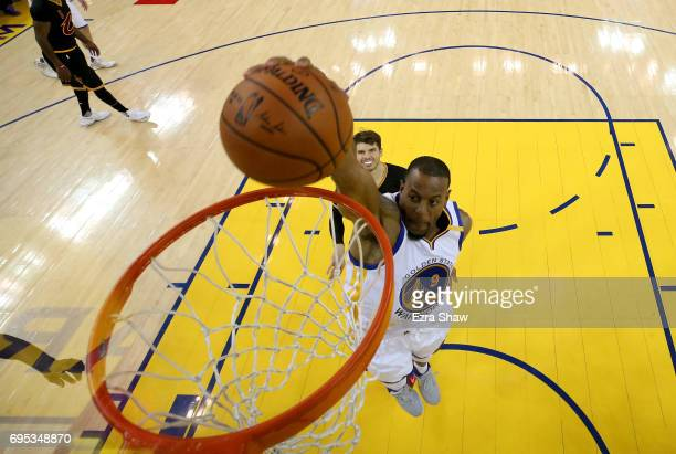 Andre Iguodala of the Golden State Warriors dunks the ball against the Cleveland Cavaliers in Game 5 of the 2017 NBA Finals at ORACLE Arena on June...