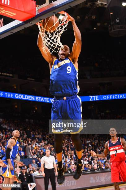 Andre Iguodala of the Golden State Warriors dunks the ball during the game against the Washington Wizards on April 2 2017 at ORACLE Arena in Oakland...