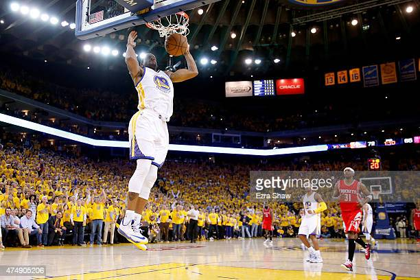 Andre Iguodala of the Golden State Warriors dunks the ball in the second half against the Houston Rockets during game five of the Western Conference...