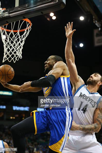 Andre Iguodala of the Golden State Warriors goes for the layup against Nikola Pekovic of the Minnesota Timberwolvesduring the game on February 11...
