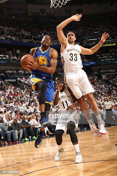 Andre Iguodala of the Golden State Warriors goes to the basket against Ryan Anderson of the New Orleans Pelicans in Game Four of the Western...