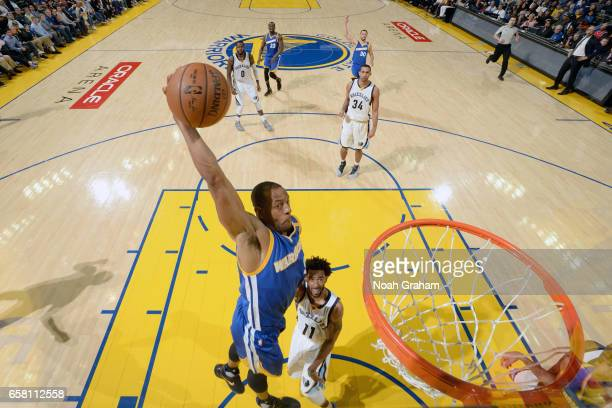 Andre Iguodala of the Golden State Warriors goes to the basket against the Memphis Grizzlies on March 26 2017 at ORACLE Arena in Oakland California...