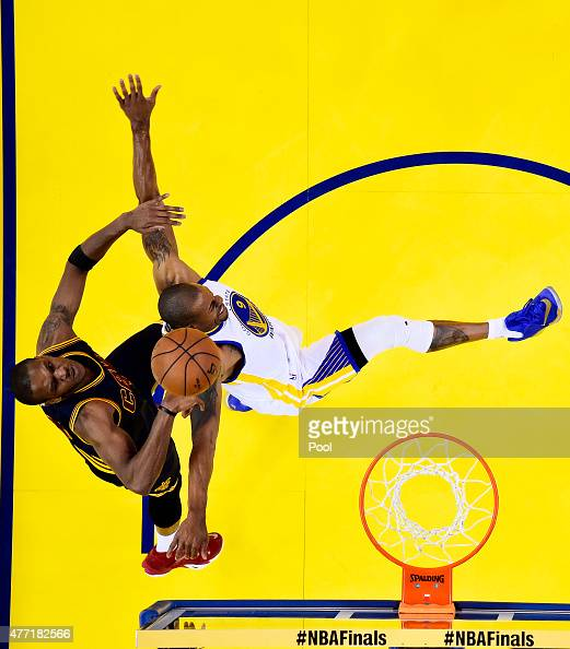 Andre Iguodala of the Golden State Warriors goes up against James Jones of the Cleveland Cavaliers in the first half during Game Five of the 2015 NBA...