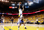 Andre Iguodala of the Golden State Warriors goes up against LeBron James of the Cleveland Cavaliers in the second quarter during Game Five of the...