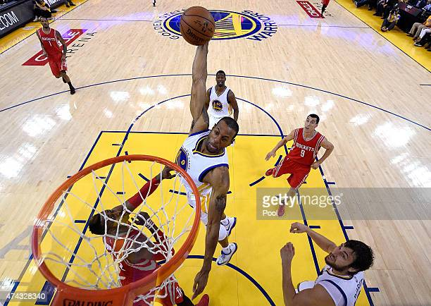 Andre Iguodala of the Golden State Warriors goes up for a dunk in the second quarter against Dwight Howard of the Houston Rockets during game two of...