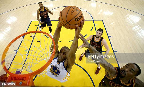 Andre Iguodala of the Golden State Warriors goes up to dunk the ball against JR Smith of the Cleveland Cavaliers in the first half in Game 1 of the...
