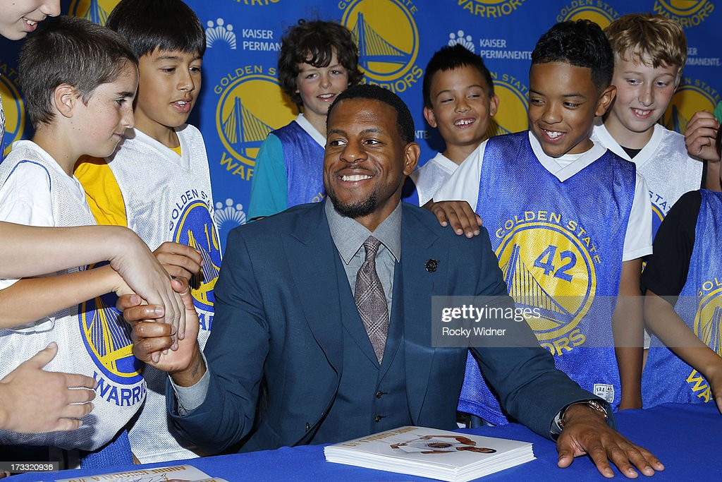 Andre Iguodala #9 of the Golden State Warriors greets kids from Warriors Basketball Camp at a press conference on July 11, 2013 in Oakland, California.