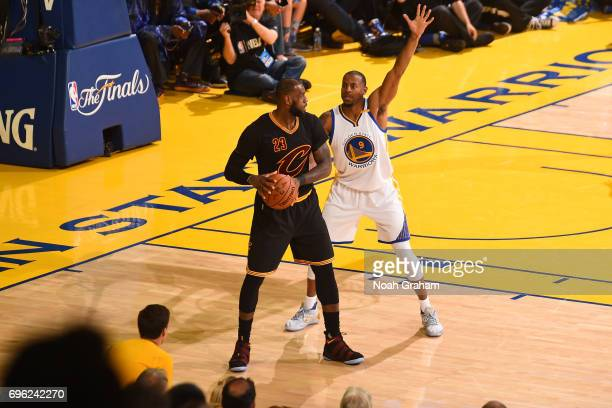 Andre Iguodala of the Golden State Warriors guards LeBron James of the Cleveland Cavaliers in Game Five of the 2017 NBA Finals on June 12 2017 at...