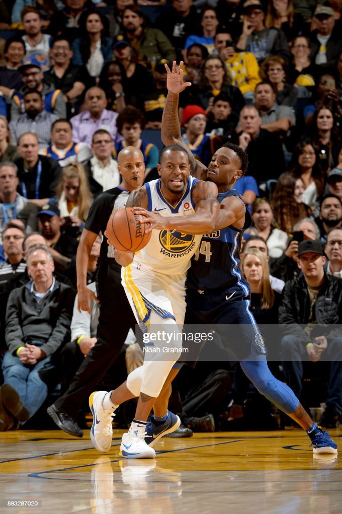 Andre Iguodala #9 of the Golden State Warriors handles the ball against the Dallas Mavericks on December 14, 2017 at ORACLE Arena in Oakland, California.