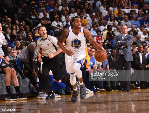 Andre Iguodala of the Golden State Warriors handles the ball during a game against the Orlando Magic on March 16 2017 at ORACLE Arena in Oakland...