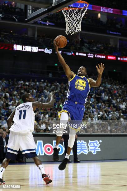 Andre Iguodala of the Golden State Warriors in action against Jamal Crawford of the Minnesota Timberwolves during the game between the Minnesota...