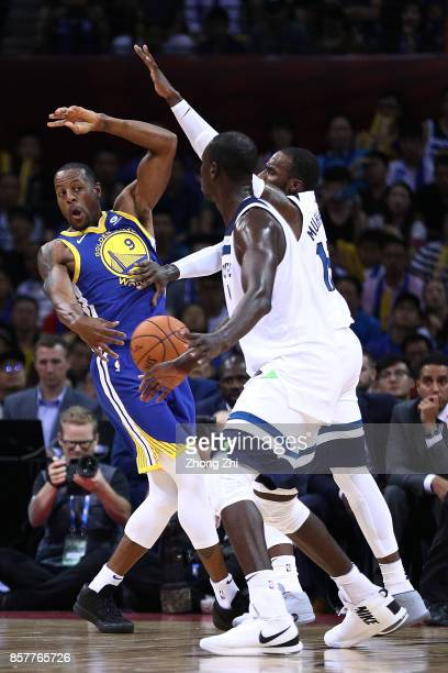 Andre Iguodala of the Golden State Warriors in action as Shabazz Muhammad the Minnesota Timberwolves defends during the game between the Minnesota...