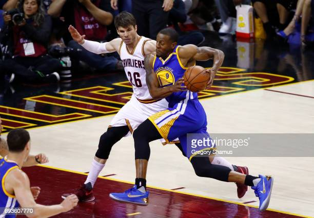 Andre Iguodala of the Golden State Warriors is defended by Kyle Korver of the Cleveland Cavaliers during the first half of Game 3 of the 2017 NBA...
