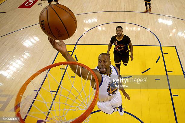 Andre Iguodala of the Golden State Warriors lays the ball up in the first half ahead of Tristan Thompson of the Cleveland Cavaliers in Game 5 of the...