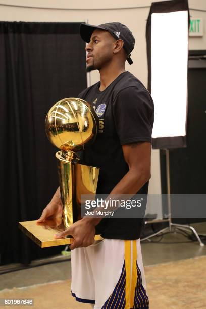 Andre Iguodala of the Golden State Warriors poses for a photo with the Larry O'Brien Trophy during the postgame celebration after Game Five of the...