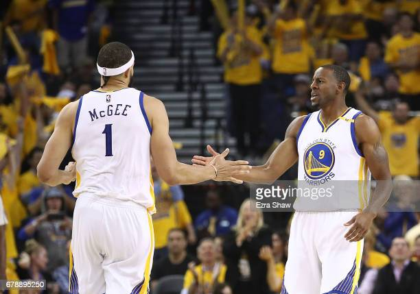 Andre Iguodala of the Golden State Warriors reacts after a dunk by JaVale McGee against the Utah Jazz during Game Two of the NBA Western Conference...