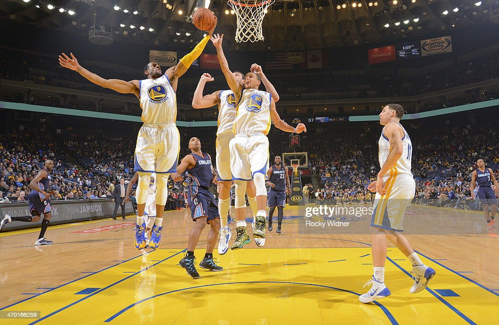 <a gi-track='captionPersonalityLinkClicked' href=/galleries/search?phrase=Andre+Iguodala&family=editorial&specificpeople=201980 ng-click='$event.stopPropagation()'>Andre Iguodala</a> #9 of the Golden State Warriors rebounds against the Charlotte Bobcats on February 4, 2014 at Oracle Arena in Oakland, California.