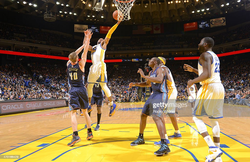<a gi-track='captionPersonalityLinkClicked' href=/galleries/search?phrase=Andre+Iguodala&family=editorial&specificpeople=201980 ng-click='$event.stopPropagation()'>Andre Iguodala</a> #9 of the Golden State Warriors shoots a layup against <a gi-track='captionPersonalityLinkClicked' href=/galleries/search?phrase=Cody+Zeller&family=editorial&specificpeople=7621233 ng-click='$event.stopPropagation()'>Cody Zeller</a> #40 of the Charlotte Bobcats on February 4, 2014 at Oracle Arena in Oakland, California.