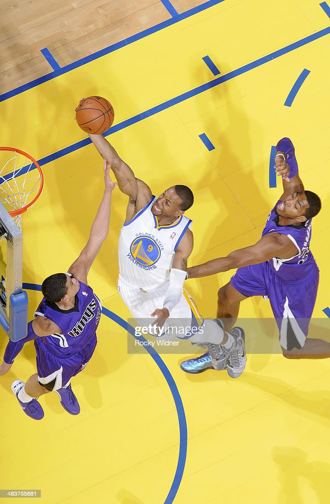 <a gi-track='captionPersonalityLinkClicked' href=/galleries/search?phrase=Andre+Iguodala&family=editorial&specificpeople=201980 ng-click='$event.stopPropagation()'>Andre Iguodala</a> #9 of the Golden State Warriors shoots a layup against Ray McCallum #3 of the Sacramento Kings on April 4, 2014 at Oracle Arena in Oakland, California.