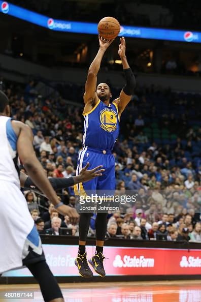Andre Iguodala of the Golden State Warriors shoots against the Minnesota Timberwolves on December 8 2014 at Target Center in Minneapolis Minnesota...